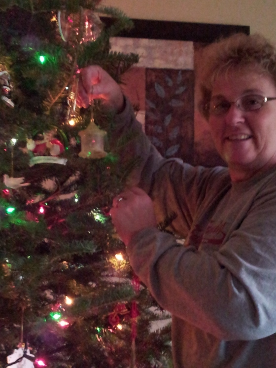 Mama hanging up her Mama's ornament :)